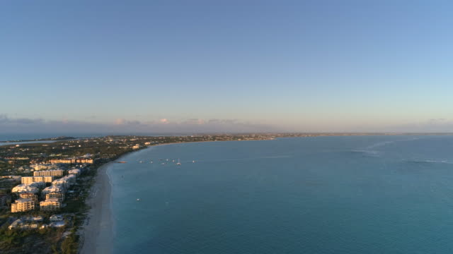 drone aerial 4k view of perfect grace bay beach at dawn light - grace bay stock videos and b-roll footage