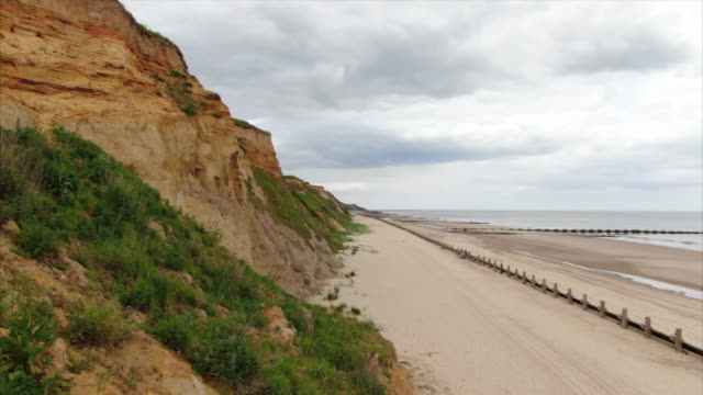drone aerial along cliffs at bacton norfolk showing coastal erosion - land stock videos & royalty-free footage