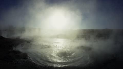 drone aerial pov of bubbling geyser - geyser stock videos & royalty-free footage