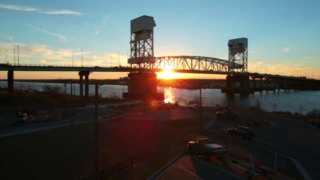 wide drone aerial cape fear memorial bridge over cape fear river at sunset - wilmington north carolina stock videos & royalty-free footage