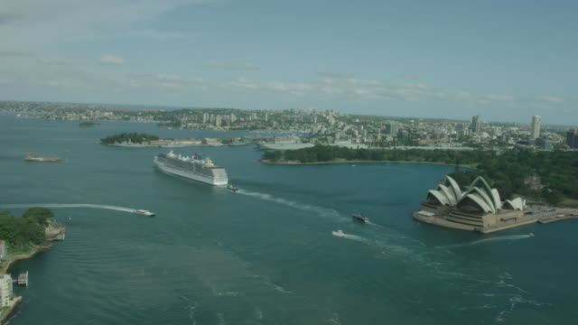 drone aerial close up to sydney harbour bridge looking east manly ferry under bridge behind tall ship with river cat passing in foreground cruise... - bennelong point stock videos and b-roll footage