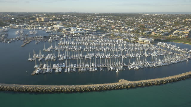 drone aerial day - fremantle, looking over the mass of boats moored in success harbour marina, including fremantle sailing club and breakwaters.... - フリーマントル点の映像素材/bロール