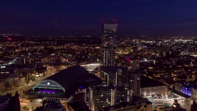 drone aerial footage of the city of manchester at night - manchester england stock videos & royalty-free footage