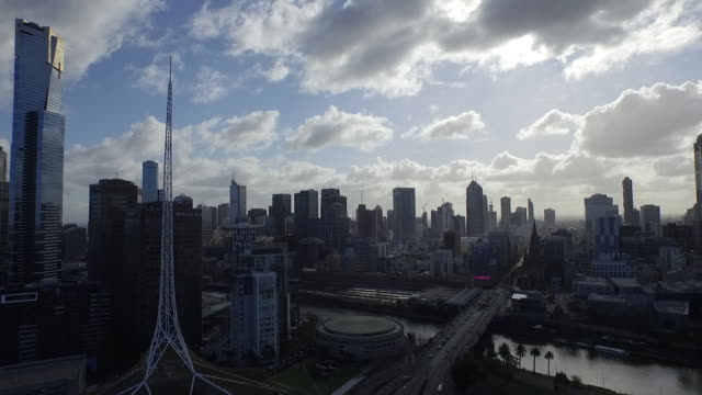 Drone aerial Melbourne CBD looking north zoom out to see Yarra River and Southbank Arts precinct buildings including Hamer Hall Arts Centre Spire...