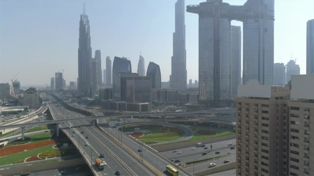 Drone aerial of E11 Sheikh Zayed Road and interchange with Burj Khalifa in background in Dubai