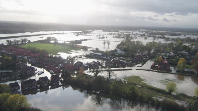 drone aerial of extensive flooding in doncaster and the village of fishlake - scenics stock videos & royalty-free footage