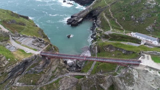 drone aerial of new footbridge linking tintagel castle to the mainland in cornwall - directly above stock videos & royalty-free footage