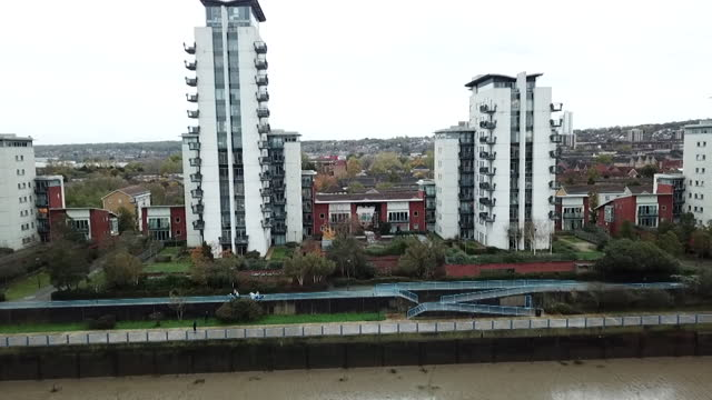 drone aerial of tower block apartments on river thames built with cladding now classed as flammable - flammable stock videos & royalty-free footage