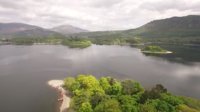 drone aerial over lake windermere - lakeshore stock videos & royalty-free footage