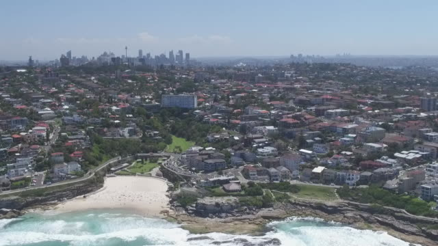 drone aerial over tamarama suburb with tamarama beach and rocks and mackenzies beach in foreground glenview court apartment building midshot looking... - bennelong point stock videos and b-roll footage