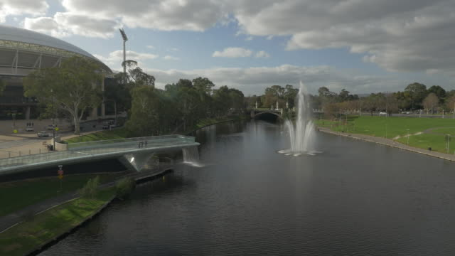 drone aerial pan adelaide - from the city over space theatre, and following across the torrens river footbridge tracking past the adelaide oval over... - footbridge stock videos & royalty-free footage