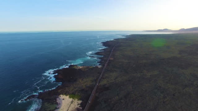 drone aerial shot of coastal road - two lane highway stock videos & royalty-free footage