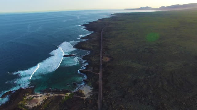drone aerial shot of coastal road - main road stock videos & royalty-free footage