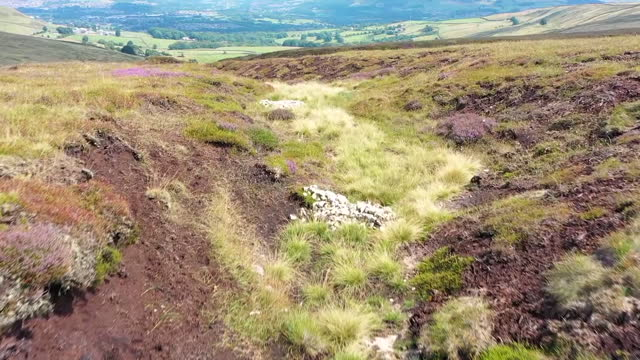 drone aerial shots of a peat bog with pools of water dug into the peat at holcombe moor on 5 august 2021 in manchester, united kingdom - soil stock videos & royalty-free footage