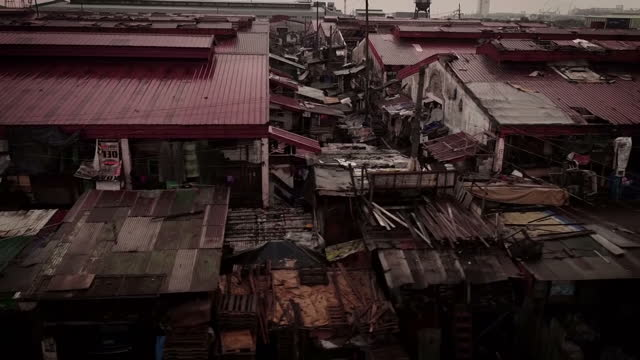 Drone aerial shots of shanty town with make shift homes in the slums in December 2016 in Manila Philippines