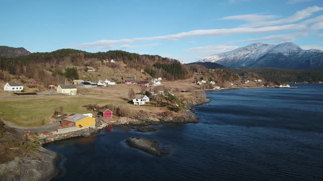 drone aerial shots of the coastal landscape near vindnes on the island of store sotra part of an archipelago in western norway including views of... - landscape scenery点の映像素材/bロール