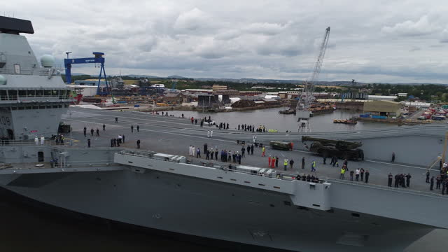 stockvideo's en b-roll-footage met drone aerial shots of the hms queen elizabeth aircraft carrier in dock during preparations to tow it out into the firth of forth to begin sea trials... - firth of forth