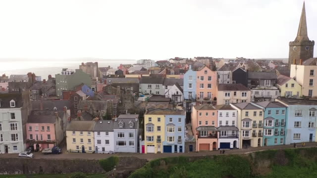 drone aerial shots over tenby houses, town and coastline on 23 october 2020 in tenby, wales, united kingdom - coastline stock videos & royalty-free footage