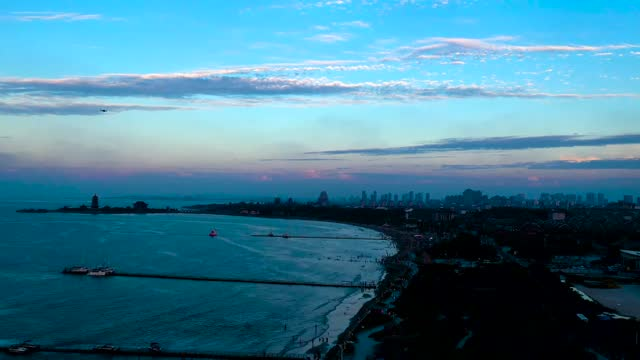 drone aerial time lapse video views of the penglai city seaside at sunset, shandong province. - east china stock videos & royalty-free footage