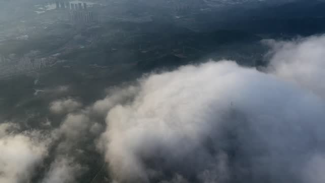 drone aerial time-lapse video of heavy clouds and fog in ninghai county, zhejiang province. - cloudscape stock videos & royalty-free footage