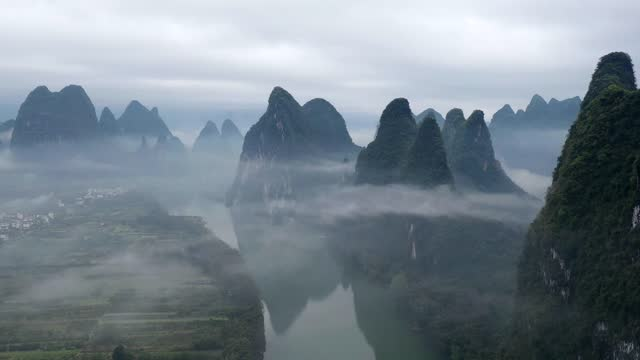 drone aerial time-lapse video of mountains surrounded by fog in yangshuo, guangxi province. footage by: costfoto / barcroft studios via getty images - time lapse stock videos & royalty-free footage