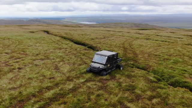 drone aerial vehicle driving over peatland restoration land northumberland - soil stock videos & royalty-free footage
