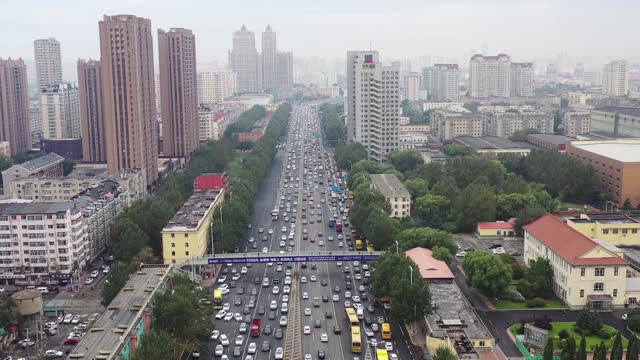 drone aerial video of heavy traffic on the second ring road during the morning rush hour in harbin city, heilongjiang province. - traffic stock videos & royalty-free footage