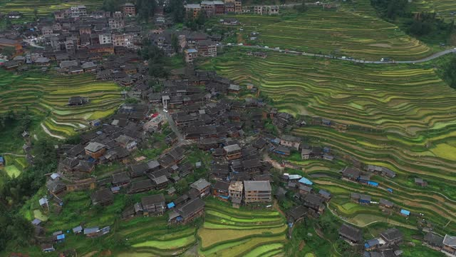 drone aerial video of rice terraces and traditional miao folk houses in the mountains in congjiang county, guizhou province. - landscape scenery stock videos & royalty-free footage