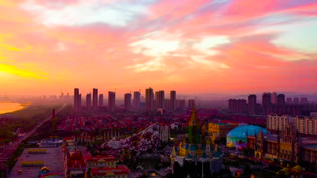 drone aerial video of sunrise skyline scenes in yantai city, shandong province. - sunrise dawn stock videos & royalty-free footage