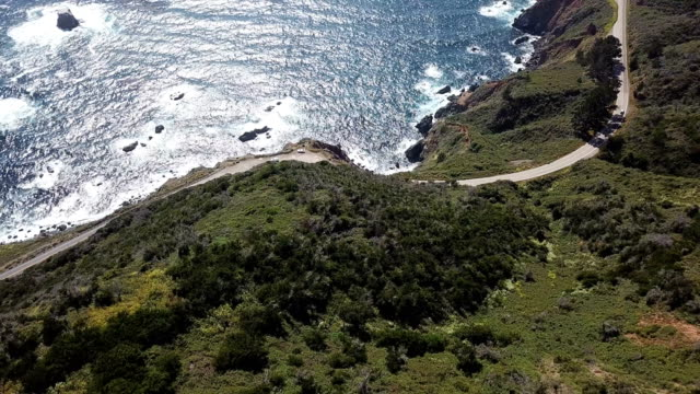 4k drone aerial video of the california coastline with mountains by big sur - bixby creek bridge stock videos & royalty-free footage