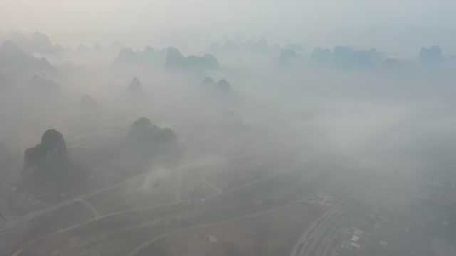 drone aerial video shows fog surrounding wanfenglin in yangshuo, guangxi zhuang autonomous region. footage by: costfoto / barcroft studios via getty... - guangxi zhuang autonomous region china stock videos & royalty-free footage