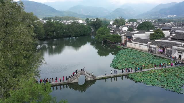 drone aerial video tourists visiting the ancient village of hongcun in huangshan city, anhui province. - village stock videos & royalty-free footage