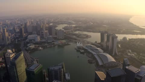vidéos et rushes de drone aerial view 4k footage of singapore skyscrapers with city. corporate offices singapore. central business district at marina bay. - singapour