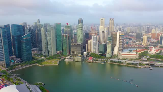 drone aerial view 4k footage of singapore skyscrapers with city. - singapore stock videos & royalty-free footage