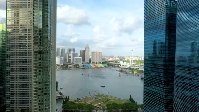 drone aerial view 4k footage of singapore skyscrapers with city. - republik singapur stock-videos und b-roll-filmmaterial