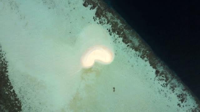 drone aerial view maldives atoll heart shape sand bank - ari atoll stock videos & royalty-free footage