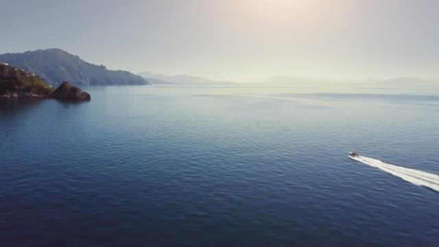 Drone aerial view of a boat sailing the sea off Amalfi coast