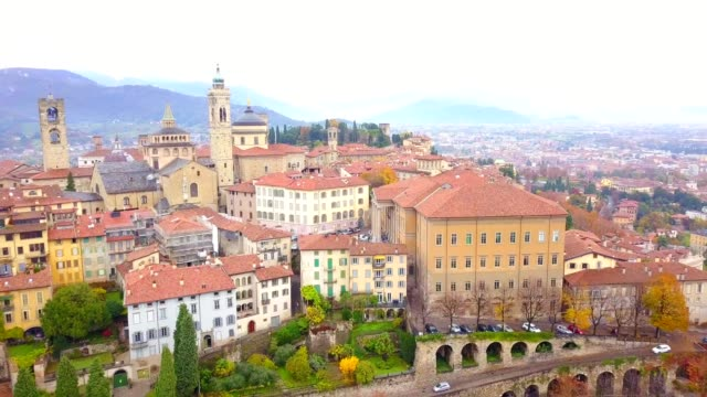 drone aerial view of famous old town bergamo bergamo is a northern italy treasure view from above with cityscape and landscape of italy - muro video stock e b–roll