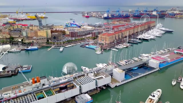 drone aerial view of famous yatch port pier of genou italy - liguria stock videos & royalty-free footage