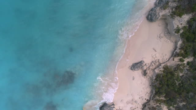Drone Aerial view of perfect beach with clear blue water in Caribbean