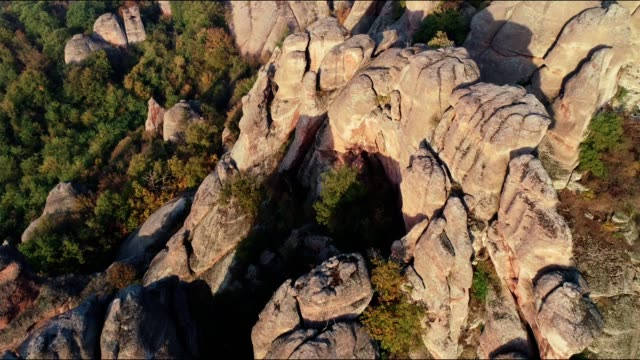 Drone: Aerial view of red rock formations, protected park, UNESCO site, cultural heritage protected