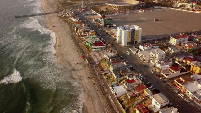 drone aerial view of the beachfront and city of tijuana, mexico - drug cartel stock videos and b-roll footage