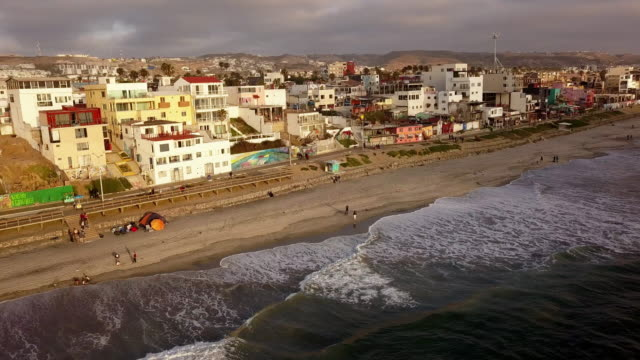 drone aerial view of the beachfront and city of tijuana, mexico - baja california norte stock videos & royalty-free footage