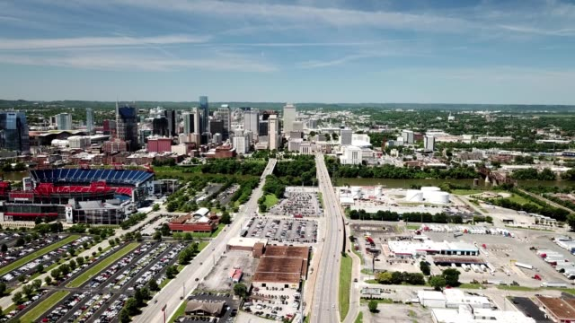 a drone aerial view of the nashville tennessee skyline and titan stadium - titan moon stock videos & royalty-free footage
