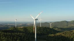 Drone aerial view of wind turbine in the country