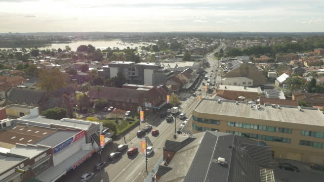 Drone aerials looking north down Great North Road Five Dock towards Canada Bay Traffic including cars trucks and bus on road