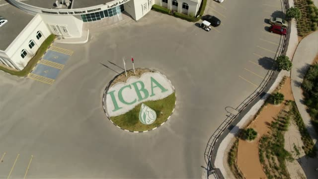 Drone aerials of International Centre for Biosaline Agriculture in Dubai flying over ICBA sign