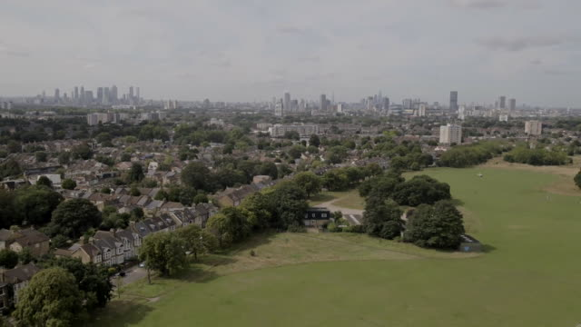 drone aerials of residentials housing estates in east london city skyline in background - skyline stock videos & royalty-free footage