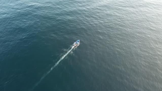 Drone aerials of speed boat sailing across Mediterranean sea near Tripoli port on 24th September in Tripoli Libya