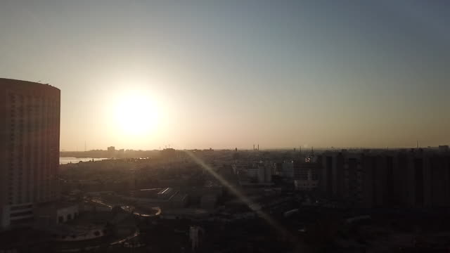 drone aerials of sunset over coast and city of tripoli and coastal skyline on 24th september 2017 in tripoli libya - libya stock videos & royalty-free footage